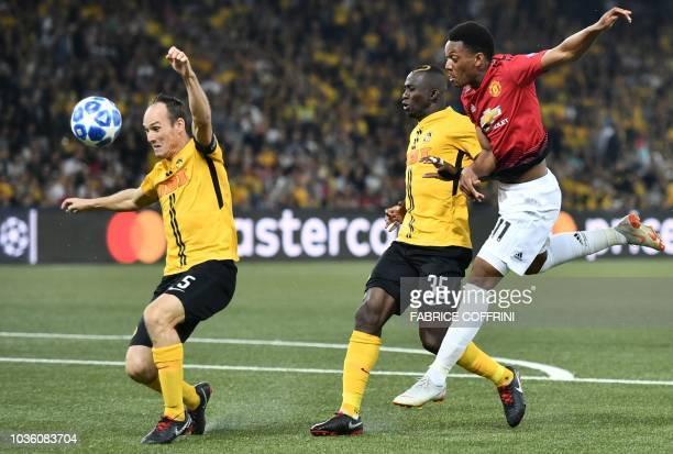 Young Boys Ivorian midfielder Sékou Sanogo and Young Boys Swiss defender Steve von Bergen defend against Manchester United's French striker Anthony...