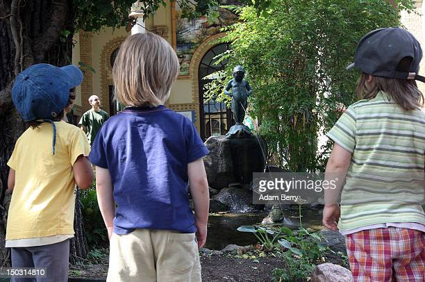 Young boys look at a fountain of a urinating child in the Berlin Zoo on August 15 2012 in Berlin Germany In 2010 nine million tourists visited the...