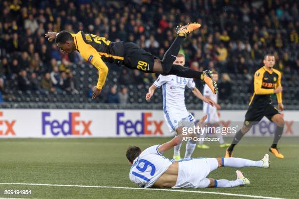 Young Boys' midfielder from Switzerland Jordan Lotomba falls over Dynamo Kiev's Ukrainian midfielder Denys Garmash during the UEFA Europa League...