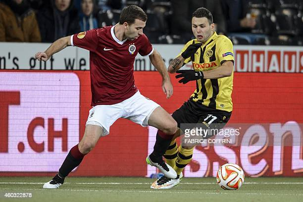 Young Boys' midfielder Renato Steffen and Sparta Prague's midfielder Josef Husbauer vie for the ball during the EUFA Europa League football match...