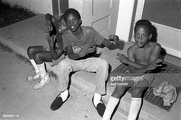 Young boys mimick their elder homies of the Grape Street Crips and throw the gang's signature 'G' and 'W' hand signs The Grape Street Watts Crips are...