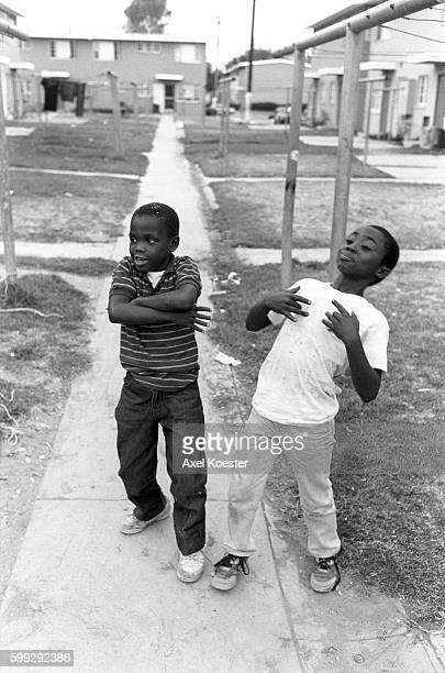 Young boys mimick their elder homies of the Grape Street Crips The Grape Street Watts Crips are a mostly African American street gang based in the...