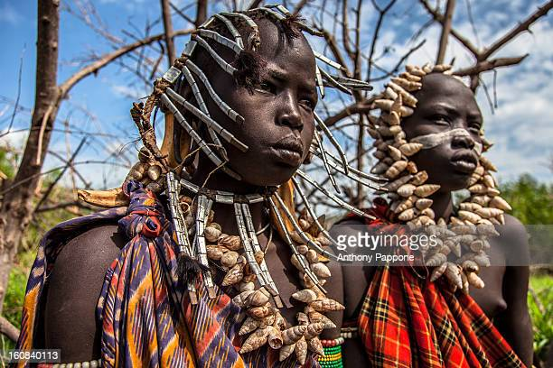 Young boys of the tribe Mursi with necklaces of shells in head. The Mursi tribe They are nomadic cattle herders live in the lower Omo Valley inside...