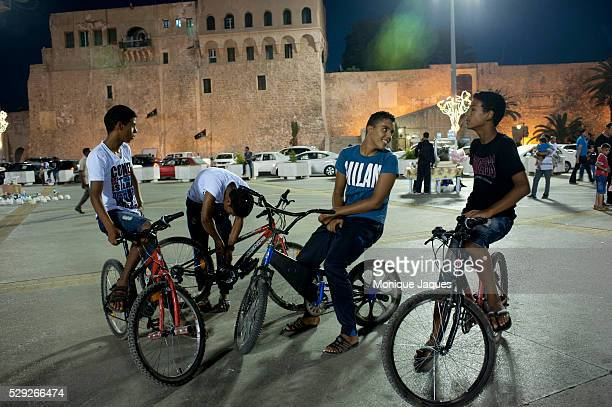 Young boys on bikes in Martyr Square in Tripoli Libya 42 years after the reign of Col Muammar Gaddafi and a violent civil war Libya is waking up to a...