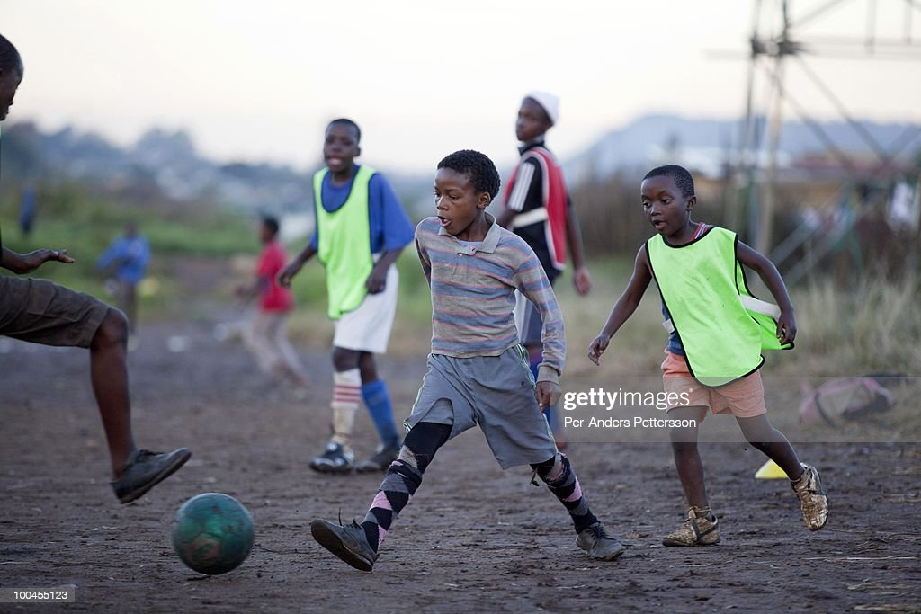 Young boys play a street soccer game on May 7, 2010, in the Motswaldi section in Soweto, Johannesburg, South Africa. Thousands of young boys play soccer in townships such as Soweto, dreaming about being the next big star. The upcoming World Cup soccer tournament in the country has greatly increased the soccer interest in the country. Many of these teams and players are very poor and can't afford proper clothes and shoes.