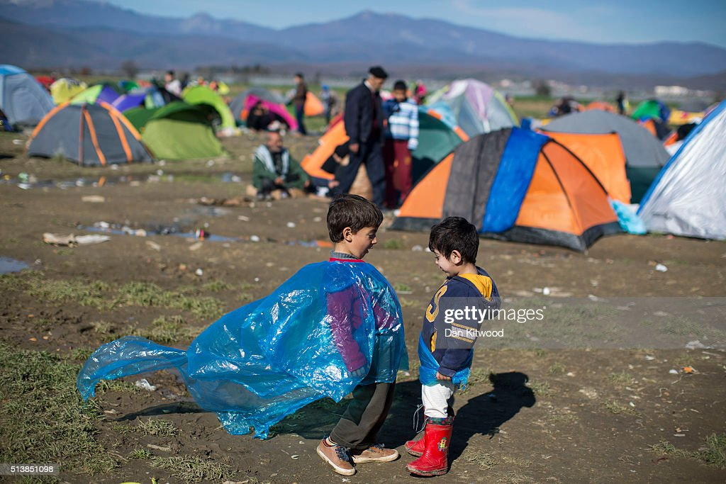 Young boys play at a refugee camp at the Greek-Macedonia border on March 05, 2016 in Idomeni, Greece. The transit camp at the border is becoming increasingly overcrowded as thousands of refugees continue to arrive from Athens and the Greek Islands. Macedonia's border with Greece remains 'open' but after allowing 580 refugees a day to cross into the country at the beginning of the week, the numbers passing have fallen dramatically with only a handful every day. According to local authorities approximately 10,000 refugees and migrants now remain stuck at the border as they wait to enter Macedonia to continue their journey North into Western Europe.