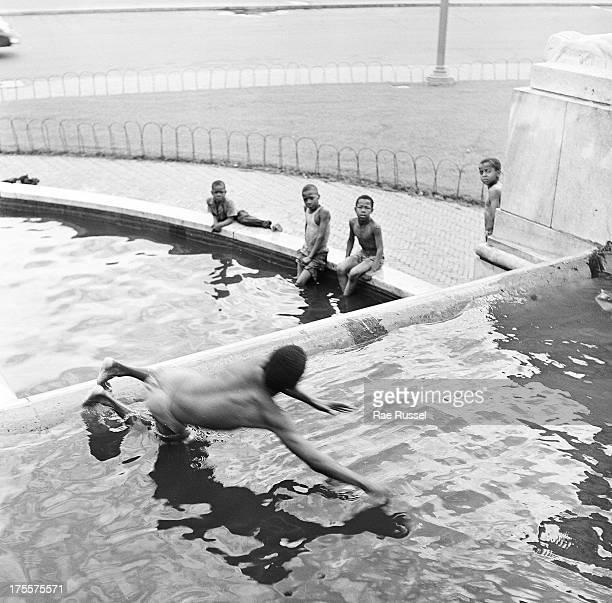 Young boys play in a public fountain, Washington DC, 1948.