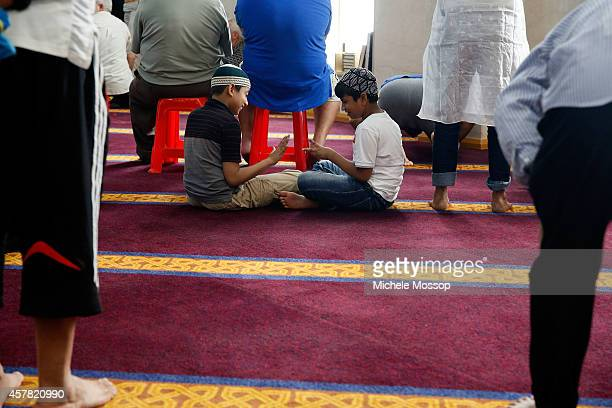 Young boys play rock paper scissors while waiting for prayers to start National Mosque open day at Lakemba mosque in the suburb of Lakemba on October...