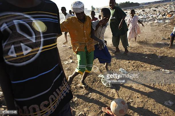 Young boys play soccer on a dump in a somali refugee camp on December 12 2008 in Djibouti The african town Djibouti is the starting point for the...