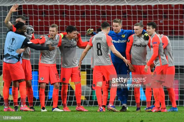 Young Boys players celebrate after the UEFA Europa League last-32, 2nd-leg football match Bayer 04 Leverkusen v Young Boys in Leverkusen, western...