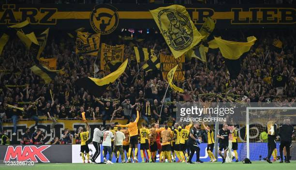 Young Boys' players celebrate with their supporters after winning the UEFA Champions League Group F football match between Young Boys and Manchester...