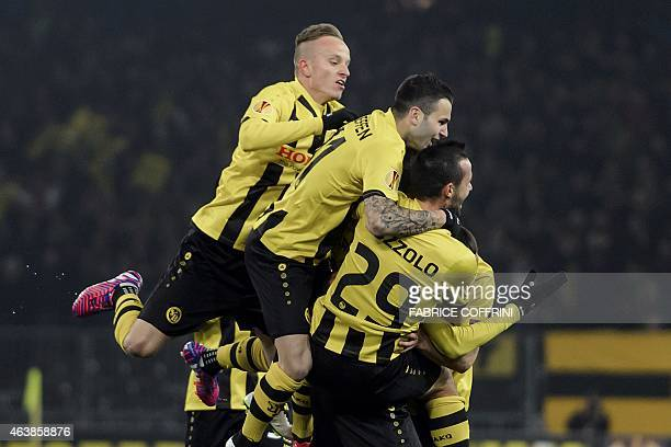 Young Boys' players celebrates after their first goal during the UEFA Europa League round of 32 first leg football match between BCS YoungBoys and...