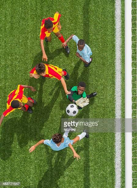 Young Boys Playing Football