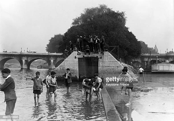 Young boys playing in the Seine river during the heat wave in July 1929 in Paris France
