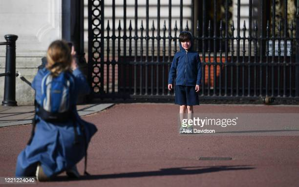 A young boys poses for a photo outside Buckingham Palace on April 26 2020 in LondonEngland The British government has extended the lockdown...
