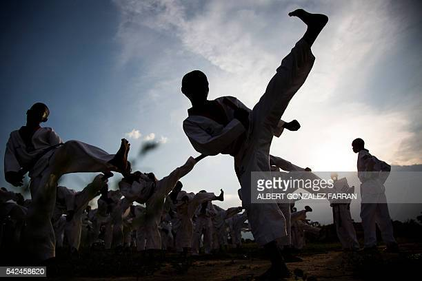TOPSHOT Young boys practise taekwondo during their daily training session at the Juba Jebel on June 23 2016 The South Sudan Taekwondo Federation...