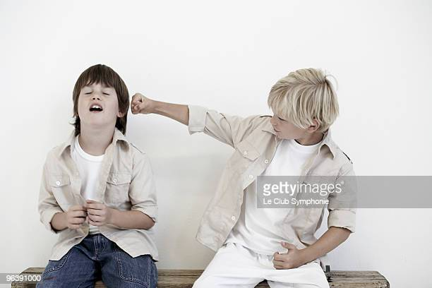 Young boys pretend fighting