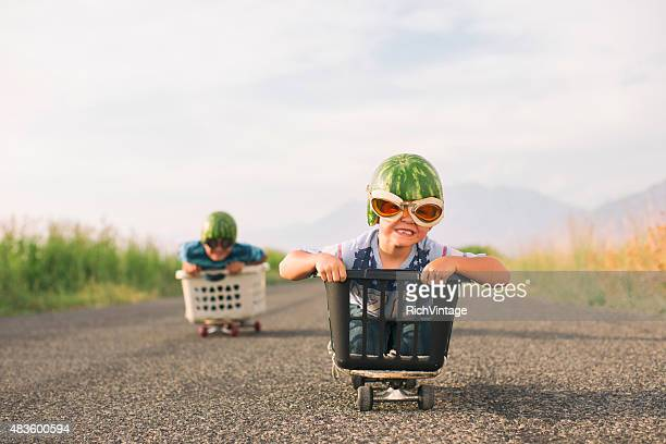 Young Boys Racing Wearing Watermelon Helmets
