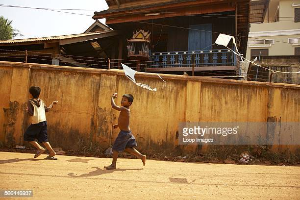 Young boys running in the streets of Siem Reap