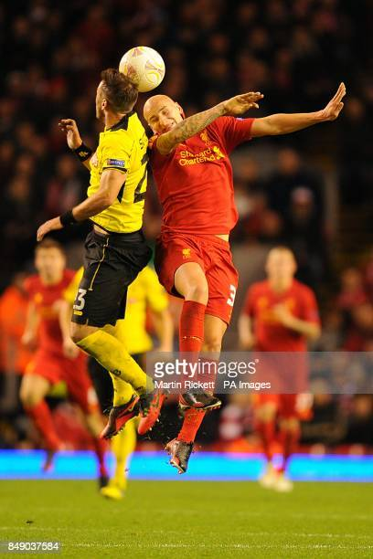 Young Boys' Scott Sutter and Liverpool's Jonjo Shelvey battle for the ball in the air