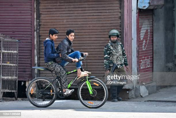 Young boys seen on a cycle during the curfew Kashmir valley is under curfew control in response to the Islamic resistance leaders called the Muslim...