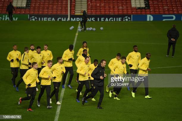 Young Boys' Swiss defender Steve von Bergen and teammates attend a training session at Old Trafford in Manchester, north west England on November 26...