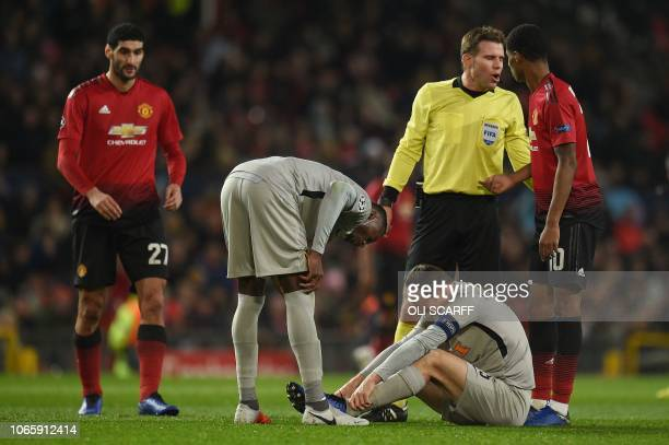 Young Boys' Swiss defender Steve von Bergen sits onthe pitch injured during the UEFA Champions League group H football match between Manchester...