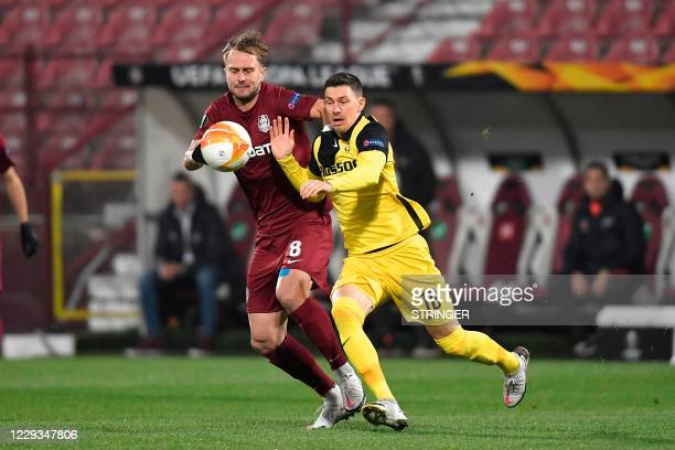Young Boys' Swiss forward Christian Fassnacht and CFR Cluj's Croatian midfielder Damjan Djokovic vie for the ball during the UEFA Europa League first...