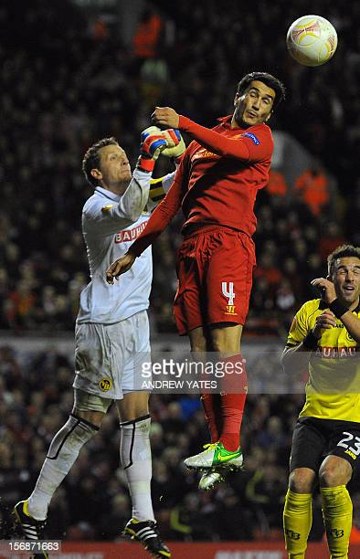 BSC Young Boys' Swiss goalkeeper Marco Wolfli clears from Liverpool's Turkish midfielder Nuri Sahin during the UEFA Europa League group A football...