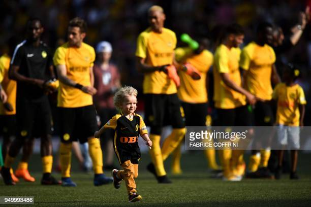 Young Boys' Swiss goalkeeper Marco Wolfli's son Yuri runs on the field at the end of the Swiss Super League football match Young Boys against...