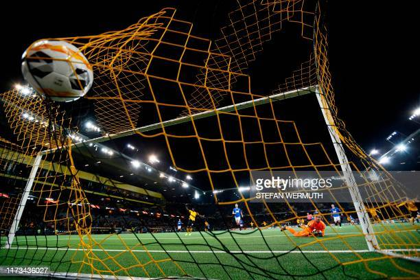 Young Boys' Swiss midfielder Christian Fassnacht shoots to score a goal against Glasgow Rangers' Scottish goalkeeper Allan McGregor during the UEFA...
