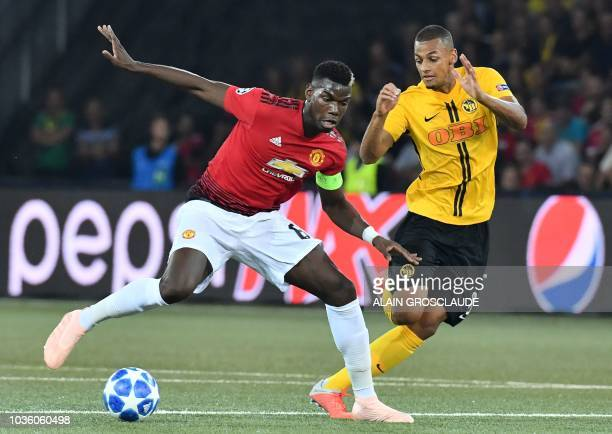 Young Boys Swiss midfielder Djibril Sow fights for the ball with Manchester United's French midfielder Paul Pogba during the UEFA Champions League...