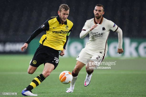 Young Boys' Swiss midfielder Fabian Lustenberger fights for the ball with Roma's Spanish forward Borja Mayoral during the UEFA Europa League Group A...
