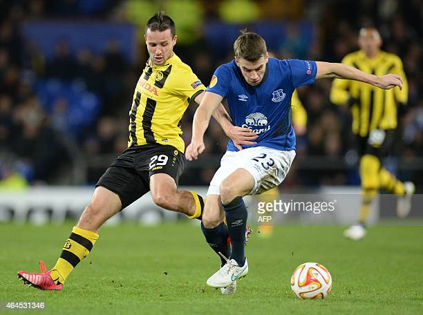 Young Boys' Swiss midfielder Raphael Nuzzolo and Everton's Irish defender Seamus Coleman vie for the ball during the UEFA Europa League round of 32...