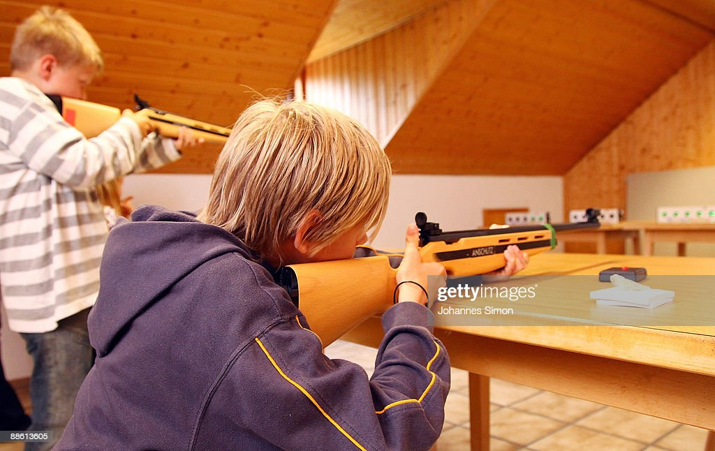 Young boys test sporting arms during a familiy open day of shooting club 'Gut Ziel' ('Aim Well') on June 21, 2009 in Olching-Geiselbullach, Germany. After Winnenden school shooting gun control debate is continued in Germany. In Olching parents are astonished about school officials who plan an installation of a shooting stand in the dwelling of recently built school.