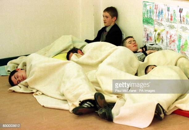 OUT** Young boys try to sleep on the floor at the Forkhill Community Centre in County of Armagh Northern Ireland this morning after they were...