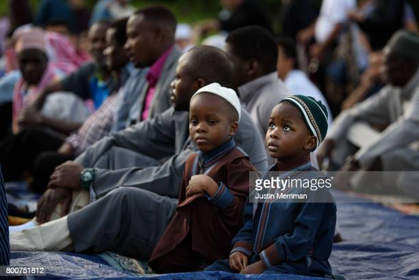 Young boys wait for the beginning of a prayer during an Eid alFitr celebration which marks the end of Ramadan on June 25 2017 in Pittsburgh...