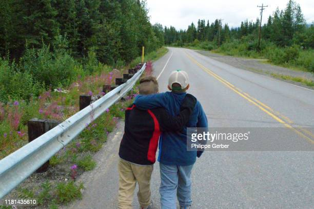young boys walking on denali highway, alaska - cantwell stock pictures, royalty-free photos & images
