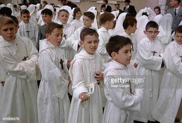 Young boys wear white robes at Pentecost Monday service at confirmation Chartres Cathedral Chartres France