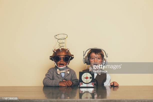 young boys with mind reading invention - inventor stock pictures, royalty-free photos & images