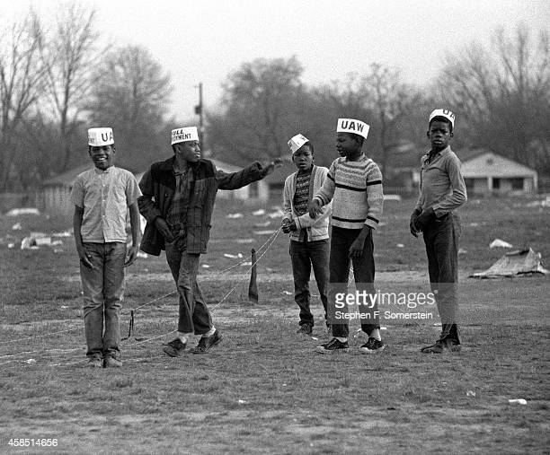 Young boys with United Auto Workers caps playing on grounds of City of St Jude School during assembly of 1965 Selma ro Montgomery civil rights march...