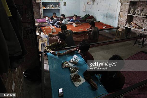 Young boys work in a textile factory November 18 2009 in Jaipur India Young boys mostly from rural area in Uttar Pradesh were bought off for 5000...