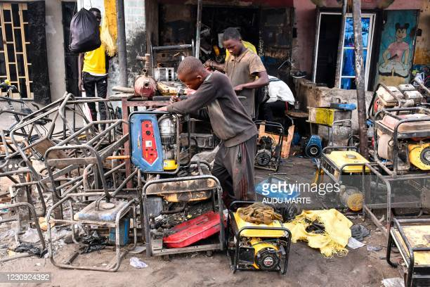 Young boys work on a generators at a workshop in the Bulabulin area of Maiduguri, on February 1, 2021. - Residents of northeast Nigerian city...