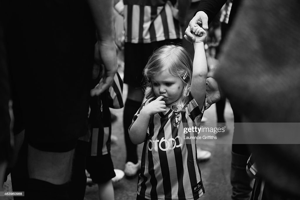 A young Bradford City fan looks on prior to the FA Cup Fifth Round match between Bradford City and Sunderland at Coral Windows Stadium, Valley Parade on February 15, 2015 in Bradford, England.