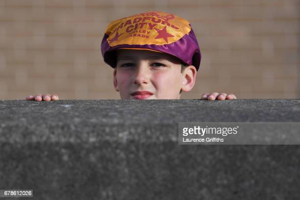 A young Bradford City fan looks over a wall prior to the Sky Bet League One playoff semi final first leg match between Bradford City and Fleetwood...