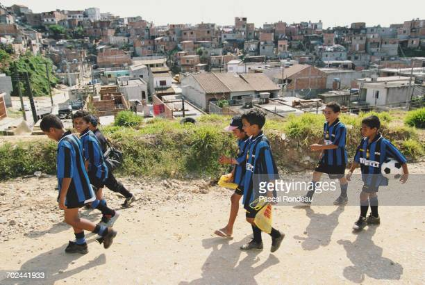 Young Brazilian boys from impoverished areas in the favelas of Brazil receive football coaching as part of the Pirelli Inter Campus education scheme...