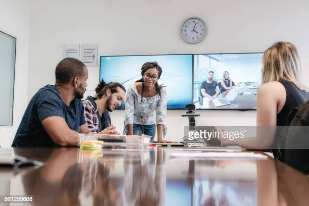 young brazilian business people in meeting room - virtual meeting stock pictures, royalty-free photos & images