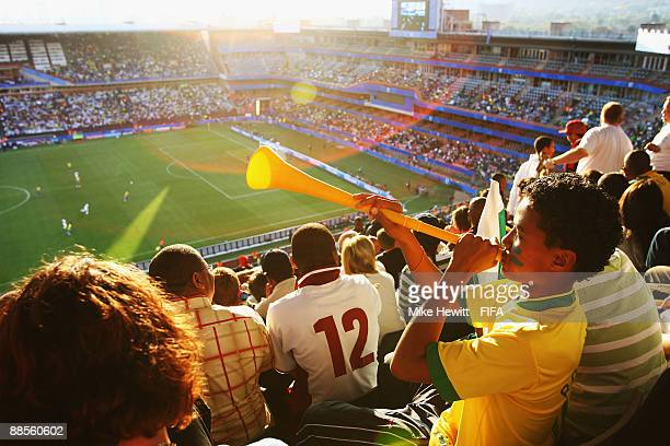A young Brazilian fan blows his horn during the FIFA Confederations Cup Group B match between USA and Brazil at the Loftus Versveld Stadium on June...
