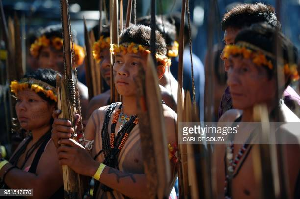 Young Brazilian indigenous men are pictured at the Acampamento Terra Livre in Brasilia on April 26 2018 Approximately 2500 indigenous people from...