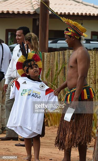 A young Brazilian native walks home with a German training jersey she was offered by players after a training session of Germany's national football...